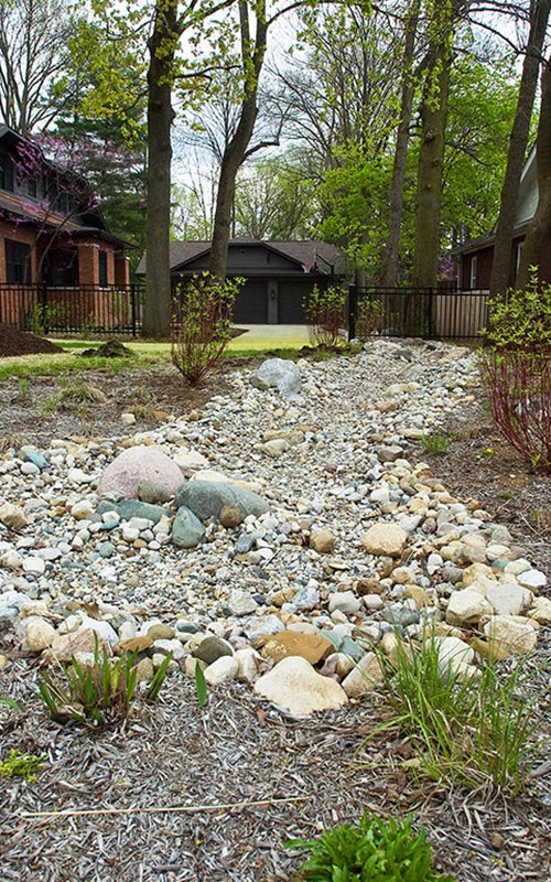 Meridian Kessler | Water Management, Hardscapes and Beautiful Plantings